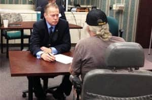 Criminal Attorney Eric Torberson assisting veteran at legal clinic.